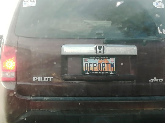 """This undated photo provided by Matt Pacenza shows a license plate on a vehicle. Utah lawmakers want to know how a license plate with the phrase """"DEPORTM"""" got approved despite state rules against expressing contempt for any race, religion or political opinion on vanity plates."""