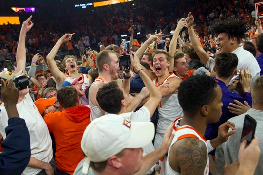 The Clemson Tigers celebrate with fans after defeating the Duke Blue Devilsat Littlejohn Coliseum.