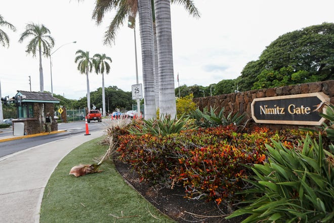 This file photo shows the Nimitz Gate entrance to Joint Base Pearl Harbor-Hickam in Honolulu. Military officials say 3 civilians were arrested after a live mortar round was found in their vehicle as they tried to enter the base without authorization.