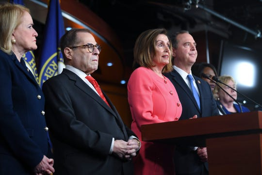 House Speaker Nancy Pelosi announces the impeachment managers at the Capitol on Jan. 15: Intelligence Committee Chairman Adam Schiff, D-Calif.; Judiciary Committee Chairman Jerry Nadler, D-N.Y.; and Reps. Hakeem Jeffries, D-N.Y.; Val Demings, D-Fla.; Zoe Lofgren, D-Calif.; Jason Crow, D-Colo.; and Sylvia Garcia, D-Texas. Schiff was named the lead manager.