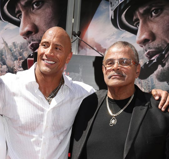 Ata Johnson, Dwayne Johnson and Rocky Johnson seen at Dwayne Johnson's Hands and Footprints Ceremony held at TCL Chinese Theatre on Tuesday, May 19, 2015, in Hollywood.