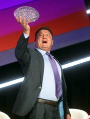 Ed Orgeron, coach of LSU's football team, shows off the Amway Coaches Poll championship trophy during The American Football Coaches Association Awards Ceremony held at Opryland in Nashville.
