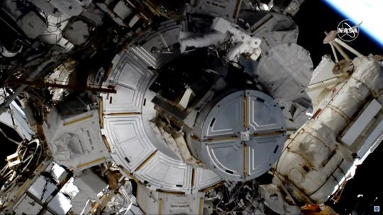 In this image taken from NASA video, astronaut Jessica Meir works to finish upgrading the International Space Station's power grid, Wednesday, Jan. 15, 2020.