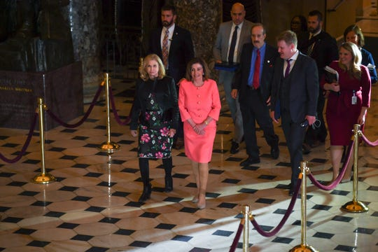 House Speaker Nancy Pelosi (D-Calif.) walks through the National Statuary Hall after House impeachment managers, led by the House Clerk and the House Sergeant at Arms, presented the articles of impeachment to the secretary of the Senate.