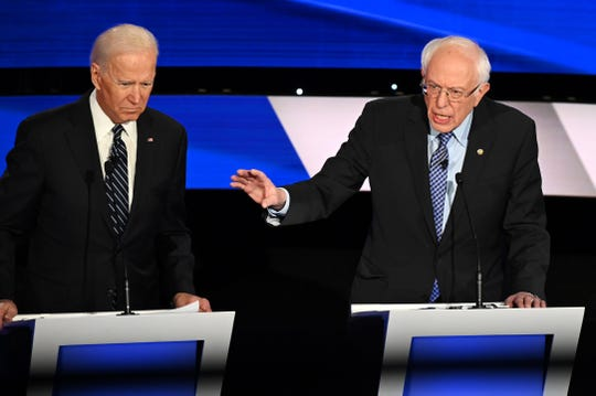 (L-R) Democratic presidential hopefuls Former Vice President Joe Biden (L) and Vermont Senator Bernie Sanders participate of the seventh Democratic primary debate of the 2020 presidential campaign season co-hosted by CNN and the Des Moines Register at the Drake University campus in Des Moines, Iowa on January 14, 2020.
