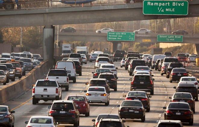 This Dec. 12, 2018, file photo shows traffic on the Hollywood Freeway in Los Angeles. The Trump administration is signaling that it could increase fuel economy standards, possibly compromising on its push to freeze them at 2020 levels. In one of the administration's hardest-fought battles to roll back Obama-era environmental regulations, two federal agencies submitted a final rule on gas mileage and greenhouse gas emissions on Tuesday, Jan. 14, 2020.
