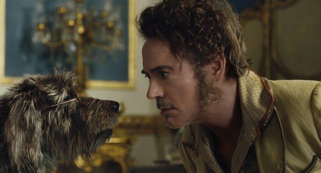 "Dog Jip (voiced by Tom Holland, left) speaks to Dr. John Dolittle (Robert Downey Jr.) in the Razzie-nominated ""Dolittle."""