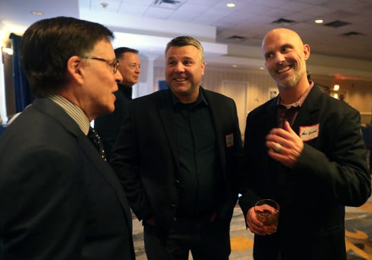 Broadcaster Bob Costas, left, listens to a story by Wisconsin Timber Rattlers manager Matt Erickson, right, before the 55th annual Red Smith Sports Awards on Jan. 15 at the Red Lion Hotel Paper Valley in Appleton.