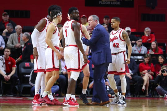 Rutgers Scarlet Knights head coach Steve Pikiell talks with his players during the first half of the college basketball game between the Rutgers Scarlet Knights and the Indiana Hoosiers