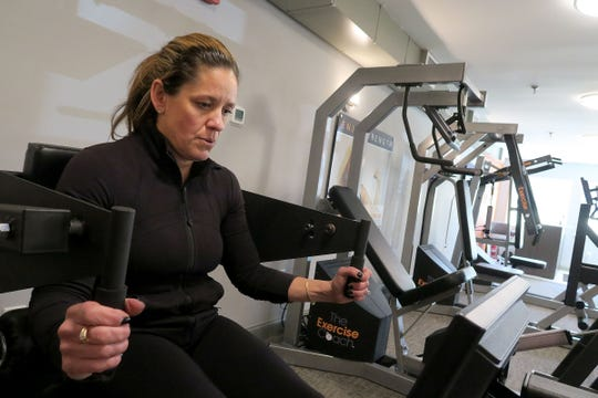 Alexandria Everett, Rumson, works on the machine that strengthens her abs and back at the Exercise Coach in Fair Haven Thursday, January 16, 2020.  The facility uses computer aided fitness machines for an efficient workout to build and strengthen muscles.