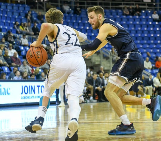 Monmouth's George Papas (right) guard's Quinnipiac's Rich Kelly during Monmouth's loss at Quinnipiac on Sunday, Jan. 12, 2020.