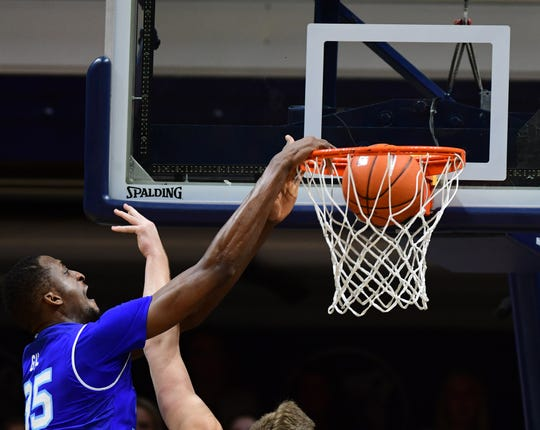 Seton Hall Pirates center Romaro Gill   (25) dunks in the second half against the Butler Bulldogs at Hinkle Fieldhouse.