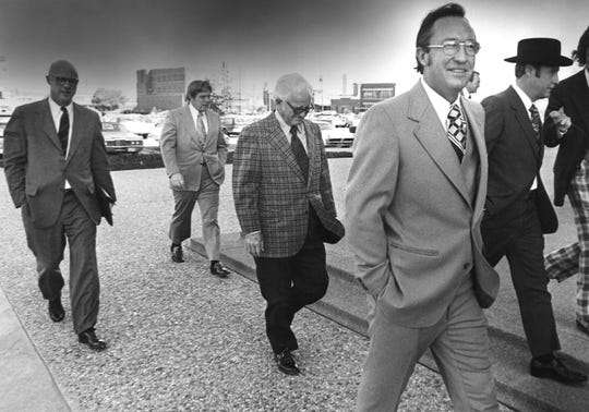 House Speaker Gus Mutscher, foreground, walks into the Taylor County Courthouse during in his 1972 trial in Abilene. Mutscher and two others were convicted of conspiracy to accept a bribe in the Sharpstown bank stock fraud scandal.