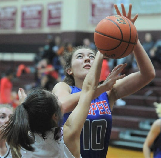 Cooper's Brianna Garcia (10) drives to the basket as Eula's Susie Luckow defends. Eula beat the Lady Cougars 46-38 in the nondistrict game Dec. 14, 2018, at Eula.