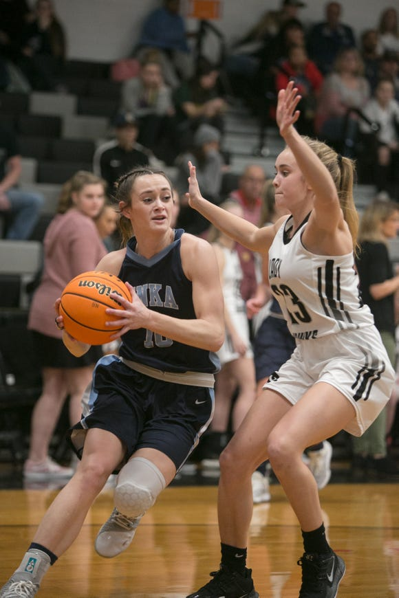Enka's Emily Carver dribbles and North Buncombe's Scotty Eubanks tries to block as the teams faced off on Jan. 15, 2020, at North Buncombe. Enka took the win with a final score of 72-69.