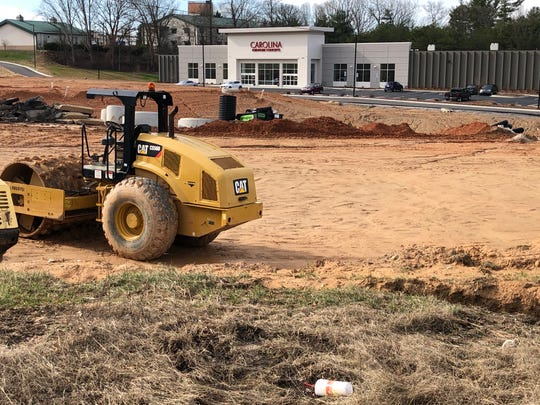 The owner of Carolina Furniture Concepts did clear parcels in front of the business for future commercial development, but he says he plans to plant a similar number of trees to those removed once building is finished. The parcels, which front Airport Road, likely will see retail and restaurant development.
