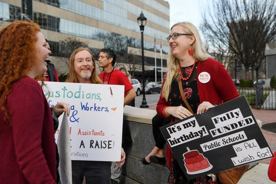 """LeAnna Delph, right, a 6th grade teacher at Eblen Intermediate and Regional Director for the North Carolina Association of Educators, talks with fellow protestors during the """"Our Schools Deserve Funds Now"""" rally at Vance Memorial in downtown Asheville January 15, 2020."""