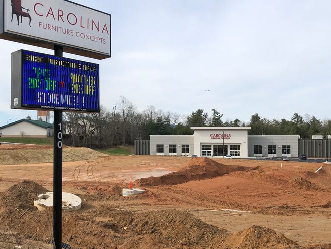 The owner of Carolina Furniture Concepts did clear parcels in front of the business for future commercial development, but he says he plans to plant a similar number of trees to those removed once building is finished.