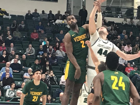 Binghamton University's Yarden Willis and Vermont's Daniel Giddens battle for the opening tip of Wednesday's America East game at the Events Center. The Bearcats lost, 72-53.