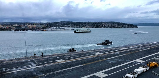 From the bridge of the USS Nimitz, Bremerton and a departing ferry can be seen on Jan. 11.