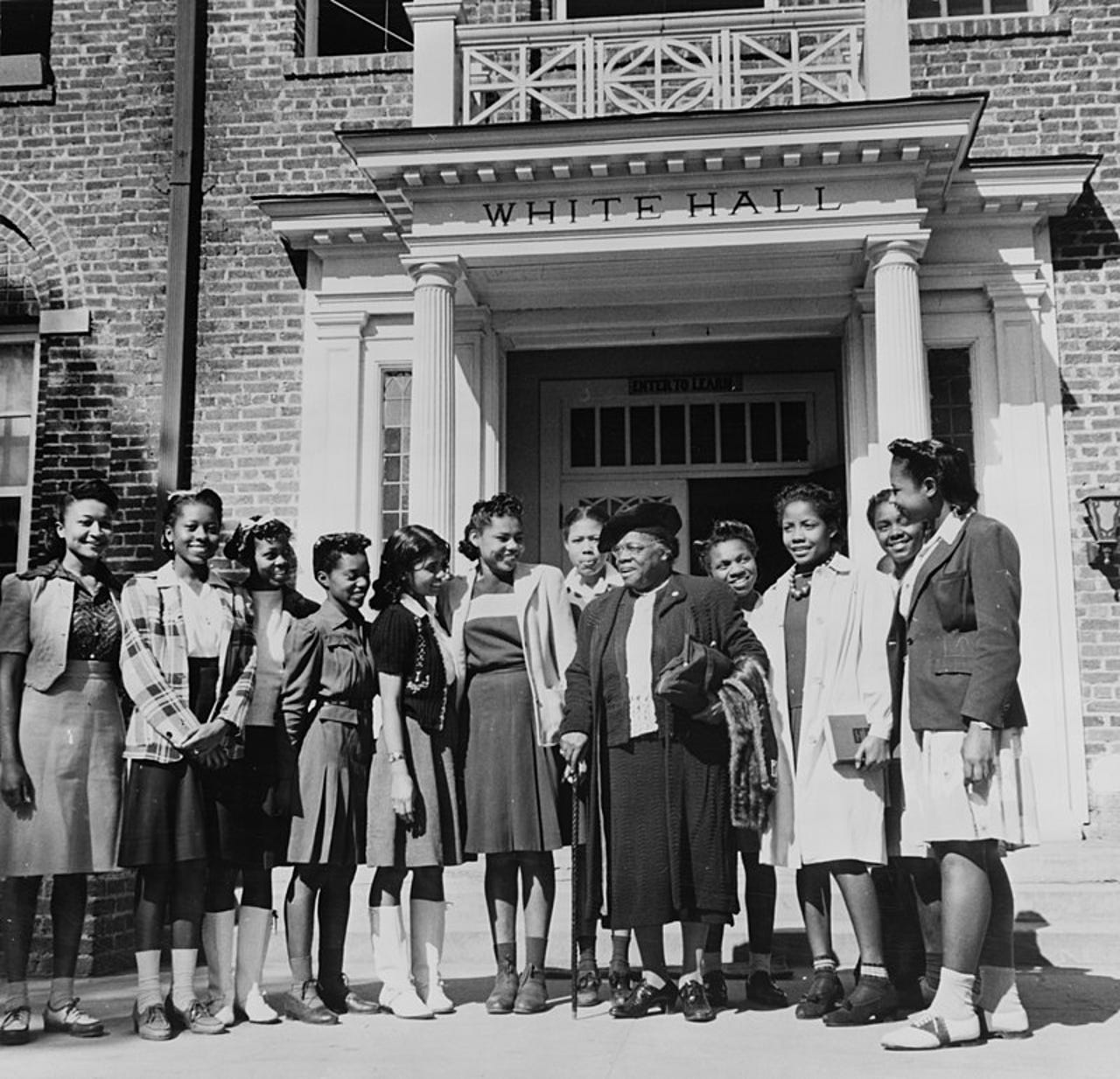 Mary McLeod Bethune outside White Hall in 1943 with a group of female students at Bethune Cookman University in Daytona Beach.