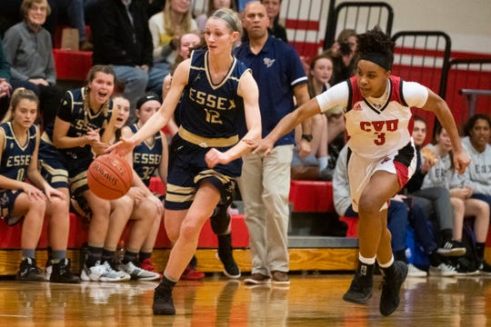 Essex's Mary Finnegan (12) dribbles the ball down the court past CVU's Mekkena Boyd (3) during the girls basketball game between the Essex Hornets and the Champlain Valley Union Redhawks at CVU High School on Wednesday night January 15, 2020 in Hinesburg, Vermont.