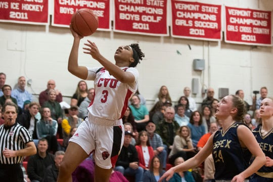 CVU's Mekkena Boyd (3) leaps for a layup during the girls basketball game between the Essex Hornets and the Champlain Valley Union Redhawks at CVU High School on Wednesday night January 15, 2020 in Hinesburg, Vermont.