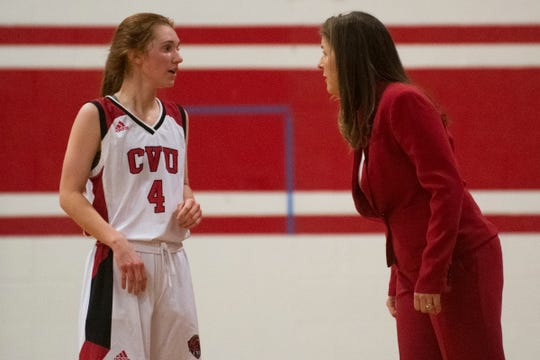 CVU head coach Ute Otley talks to Catherine Gilwee (4) during the girls basketball game between the Essex Hornets and the Champlain Valley Union Redhawks at CVU High School on Wednesday night January 15, 2020 in Hinesburg, Vermont.