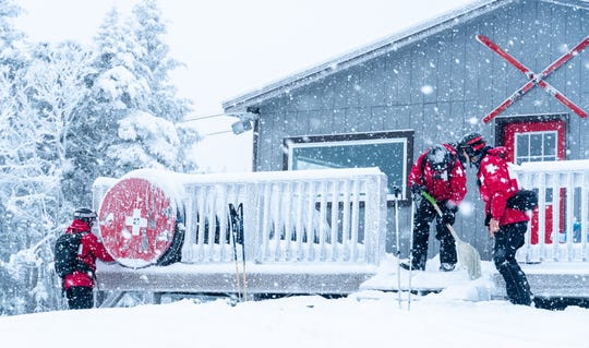 Ski patrol at Bolton Valley Resort shovels off their hut on Thursday morning, Jan. 16, 2020, as a winter storm continued to dump snow on the Green Mountains. Northern Vermont was expected to get anywhere from 6 inches to nearly a foot of snow in the higher elevations.