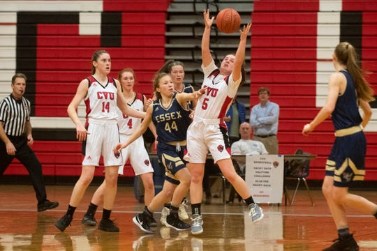 CVU's Maryn Askew (5) grabs the rebound during the girls basketball game between the Essex Hornets and the Champlain Valley Union Redhawks at CVU High School on Wednesday night January 15, 2020 in Hinesburg, Vermont.
