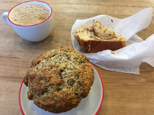 A lemon poppyseed muffin (and bonus slice of almond babka) at Great Harvest Bread Co. in Burlington.