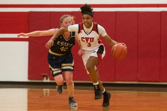 CVU's Mekkena Boyd (2) dribbles the ball down the court past Essex's Anna Sabourin (42) during the girls basketball game between the Essex Hornets and the Champlain Valley Union Redhawks at CVU High School on Wednesday night January 15, 2020 in Hinesburg, Vermont.