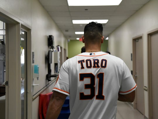 The Houston Astros' Abraham Toro walks down the Driscoll Children's Hospital halls, Thursday, Jan. 16, 2020. Toro was the 2019 Hooks Player of the Year.
