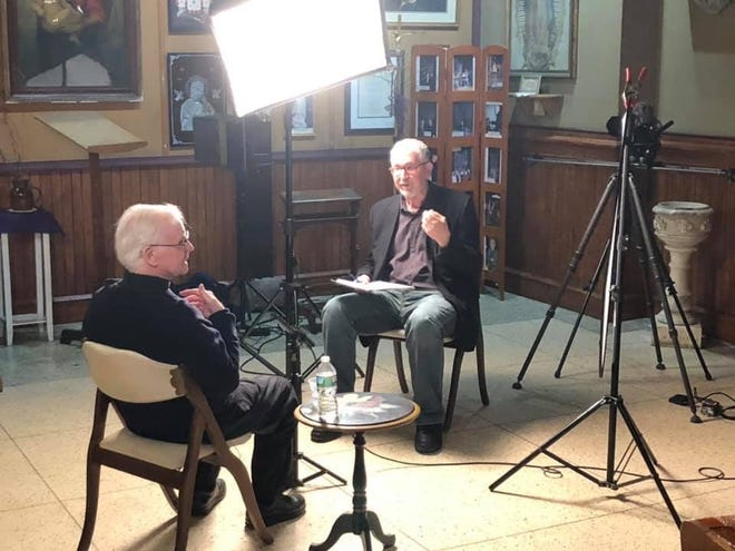Filmmaker Bill Horin (right) interviews Michael Doyle for a documentary on the priest and his legacy in South Camden.
