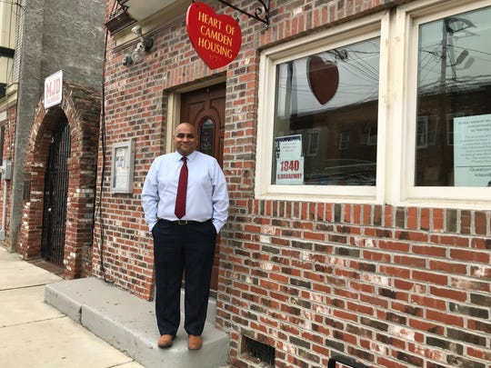 Carlos Morales, standing outside Heart of Camden's Broadway office, was among the first beneficiaries of the nonprofit's work. Today, he is its executive director.