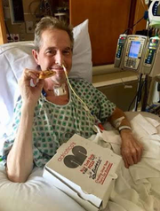 Scot Ashton enjoying pizza after his double lung transplant.