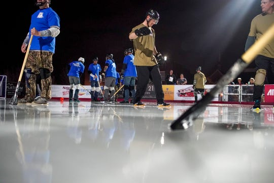 Montgomery County employees face off against soldiers from Fort Campbell in the annual General vs Mayor Broomball game at the Downtown Commons Ice Rink in Clarksville, Tenn., on Wednesday, Jan. 15, 2020.