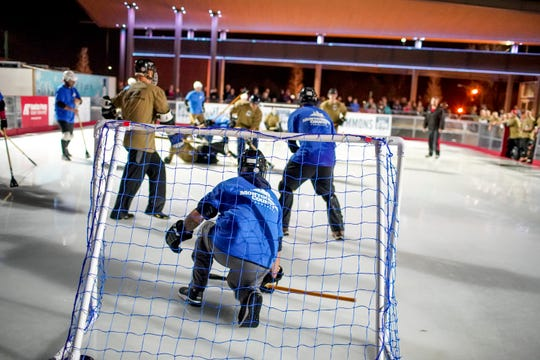 Montgomery County employees face off against soldiers from Fort Campbell in the annual General vs Mayor Broomball game at the Downtown Commons Ice Rink in Clarksville, Tenn., on Jan. 15, 2020.