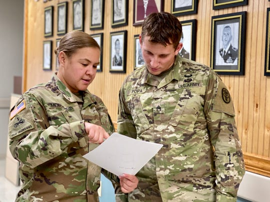 Fort Campbell Warrior Transition Battalion Platoon Sergeant, Sgt. 1st Class Elizabeth Mercedes, speaks with WTB Squad Leader, Staff Sgt. Robert Popa at the battalion. Mercedes was selected as the best platoon sergeant for 2019 in the Army Recovery Care Program Cadre of Excellence Awards for her dedication and support to wounded, ill and injured Soldiers assigned to the Fort Campbell WTB. U.S. Army photo by Maria Yager.