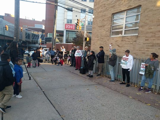 Activists outside of Lincoln Annex School opposing any plans of expanding the Cancer Institute of New Jersey that would affect the school.