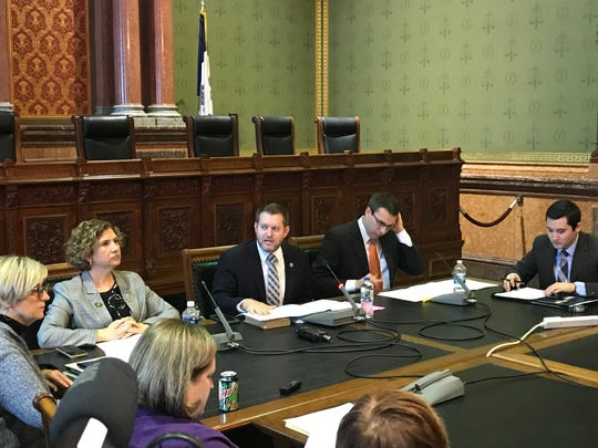 Iowa state senators meeting at the Iowa Capitol on Thursday, from left, Claire Celsi, D-West Des Moines, Jake Chapman, R-Adel, and Roby Smith, R-Davenport, consider a proposed amendment to Iowa's Constitution that would state that the constitution does not recognize or grant the right to abortion.