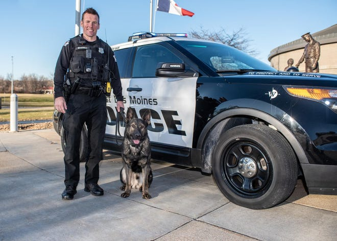West Des Moines police K-9 Murphy, pictured with his handler Officer Curtis Russell, has located more than 40 pounds of methamphetamine since arriving in the city last March, according to police.