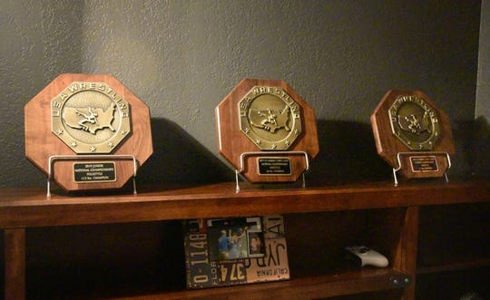 Drake Ayala keeps his national championship plaques lined up in his bedroom. The Fort Dodge junior has won a Junior men's freestyle title, a Cadet freestyle title and a Junior folkstyle title. He's currently ranked No. 2 nationally at 120 pounds.