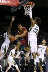 Iowa State guard Rasir Bolton passes the ball between Baylor guard Davion Mitchell and forward Freddie Gillespie on Jan. 15 in Waco.