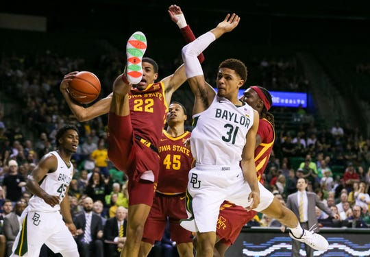 Jan 15, 2020; Waco, Texas, USA; Iowa State Cyclones guard Tyrese Haliburton (22) grabs the the rebound in front of Baylor Bears guard MaCio Teague (31) during the second half at Ferrell Center. Mandatory Credit: Raymond Carlin III-USA TODAY Sports