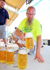 Firetrucker Brewery founder and brewmaster Dan Heiderscheit prepares for the beer stein holding contest during the 2017 Ankeny Oktoberfest.