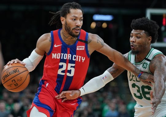 Pistons guard Derrick Rose drives the ball against Celtics guard Marcus Smart in the first quarter at TD Garden, Jan. 15, 2020.