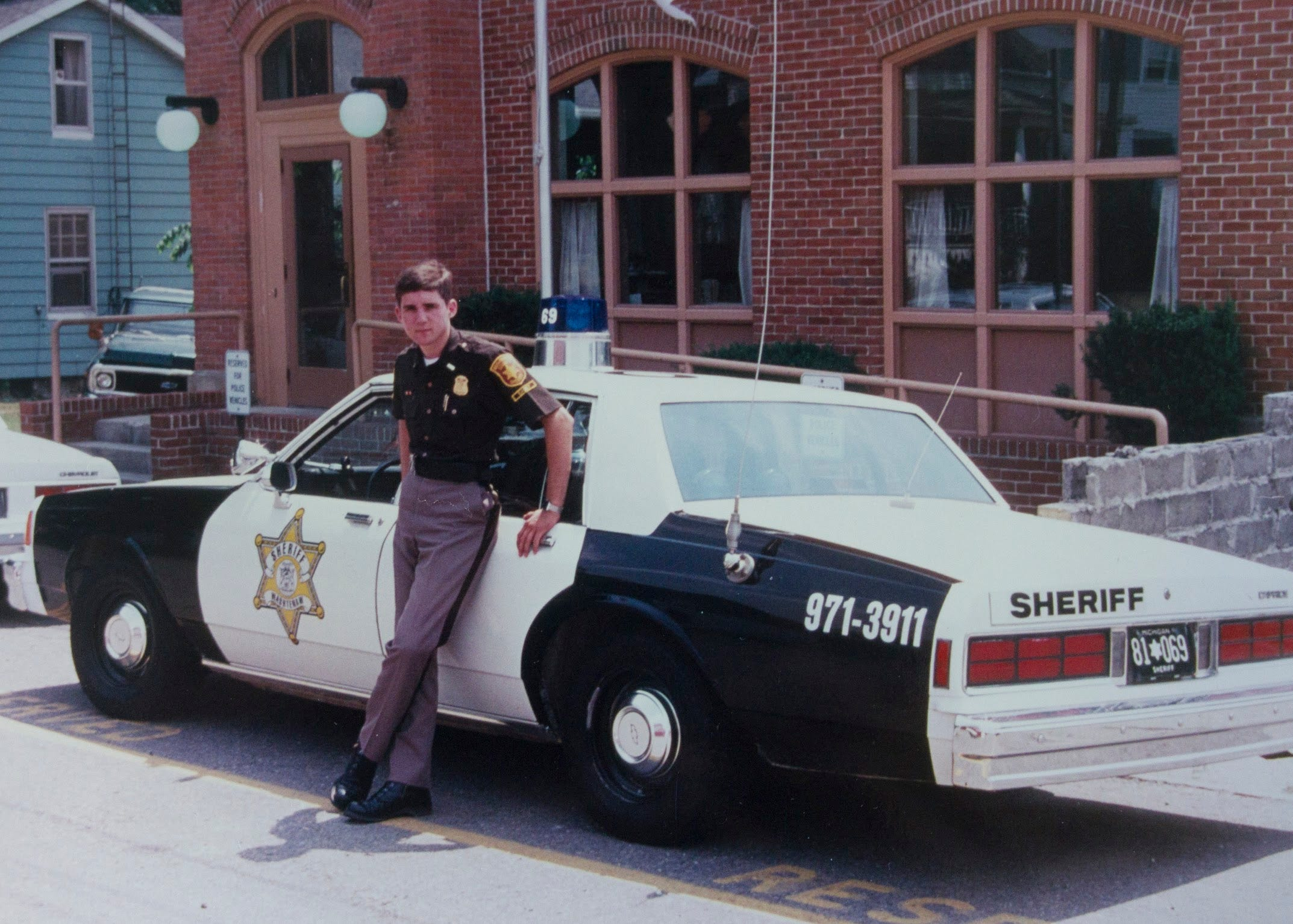 Paul Whelan poses in front of a Washtenaw County Sheriff's vehicle in this undated photo.