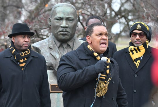 EMU alumnus James Lewis, center right, speaks before the MLK Commemorative Walk.
