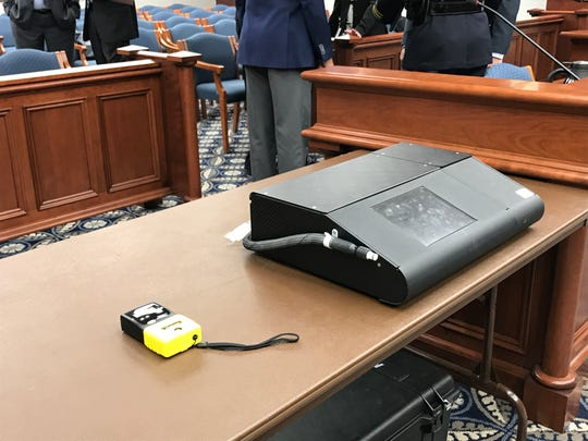 A roadside preliminary breath test device (left) sits beside a DataMaster DMT breath alcohol test instrument in Lansing ahead of a Senate Judiciary and Public Safety Committee hearing on issues with the device that could impact drunken driving cases statewide.
